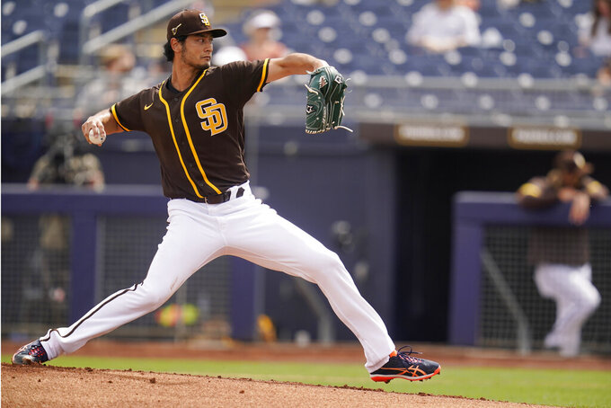 San Diego Padres' You Darvish pitches in the first inning of a spring training baseball game against the Kansas City Royals, Sunday, March 7, 2021, in Peoria, Ariz. (AP Photo/Sue Ogrocki)