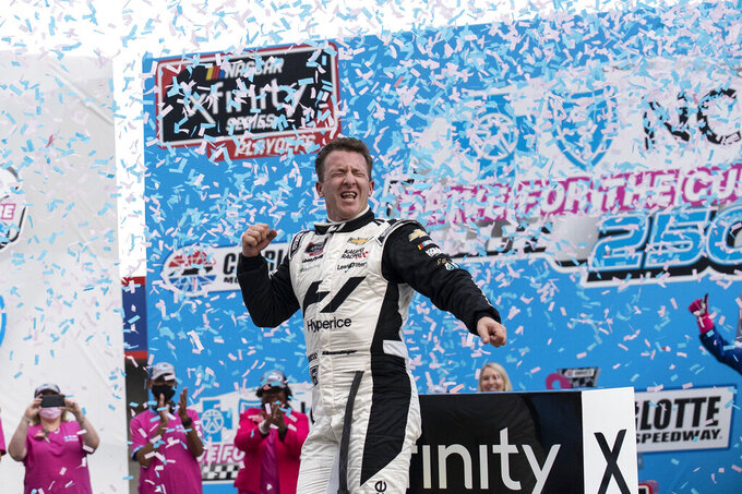 NASCAR Xfinity Series driver AJ Allmendinger (16) celebrates in victory lane after winning the NASCAR Xfinity auto racing race at the Charlotte Motor Speedway Saturday, Oct. 9, 2021, in Concord, N.C. (AP Photo/Matt Kelley)