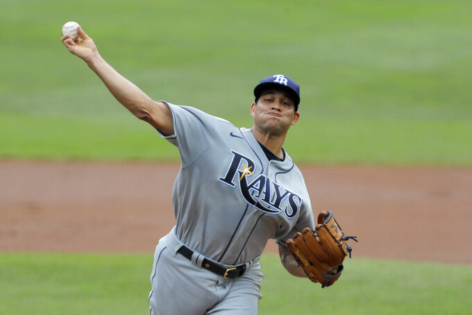 Tampa Bay Rays relief pitcher Yonny Chirinos throws a pitch to the Baltimore Orioles during the first inning of a baseball game, Sun, Aug. 2, 2020, in Baltimore. (AP Photo/Julio Cortez)