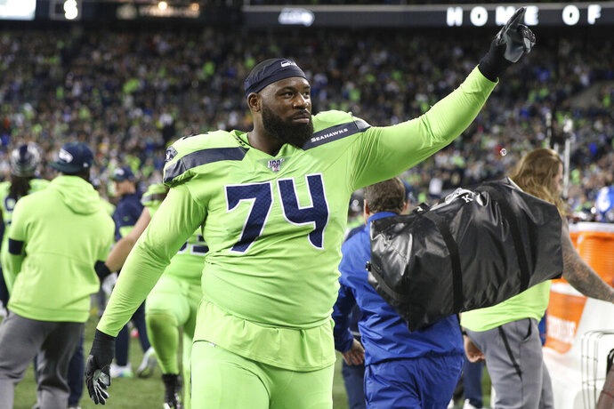 Seattle Seahawks offensive tackle George Fant (74) celebrates a win during an NFL game against the Los Angeles Rams, Thursday, Oct. 3, 2019, in Seattle. The Seahawks defeated the Rams 30-29. (Margaret Bowles via AP)