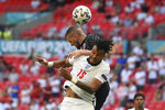England's Tyrone Mings and Croatia's Ante Rebic, top, jump for the ball during the Euro 2020 soccer championship group D match between England and Croatia, at Wembley stadium, London, Sunday, June 13, 2021. (Laurence Griffiths, Pool via AP)