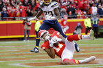 Kansas City Chiefs wide receiver Demarcus Robinson (11) makes a touchdown catch in front of Los Angeles Chargers safety Rayshawn Jenkins (23) during the first half of an NFL football game in Kansas City, Mo., Sunday, Dec. 29, 2019. (AP Photo/Charlie Riedel)