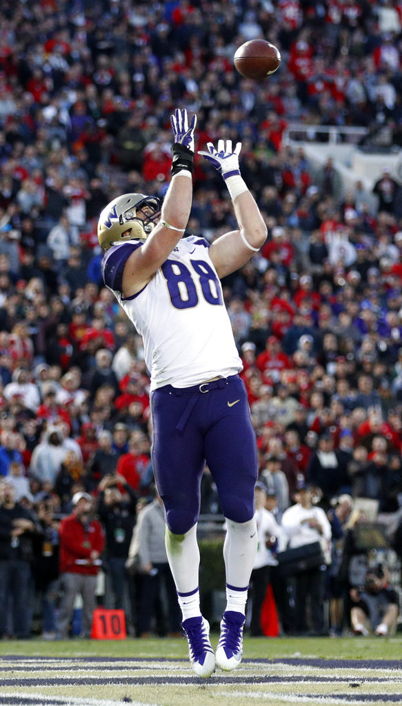 Washington tight end Drew Sample catches a pass in the end zone against Ohio State during the second half of the Rose Bowl NCAA college football game Tuesday, Jan. 1, 2019, in Pasadena, Calif. (AP Photo/Jae C. Hong)
