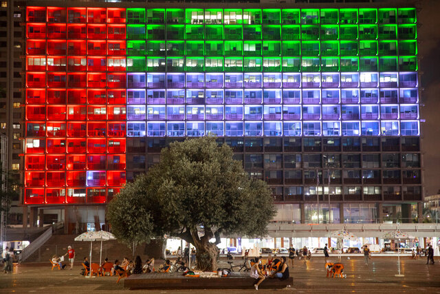 FILE - In this Aug. 13, 2020, file photo, Tel Aviv City Hall is lit up with the flag of the United Arab Emirates as UAE and Israel announced they would be establishing full diplomatic ties, in Tel Aviv, Israel.Iran's powerful Revolutionary Guard vowed on Saturday, Aug. 15, 2020 that there would be dangerous consequences for the United Arab Emirates after it announced a historic deal with Israel to open up diplomatic relations. (AP Photo/Oded Balilty, File)
