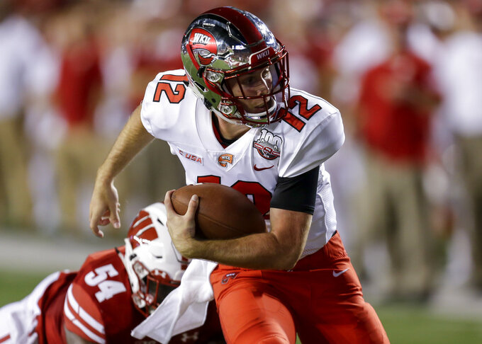 Western Kentucky quarterback Davis Shanley runs from Wisconsin linebacker Chris Orr during the second half of an NCAA college football game Friday, Aug. 31, 2018, in Madison, Wis. Shanley fumbled on the play turning it over to Wisconsin. Wisconsin won 34-3. (AP Photo/Andy Manis)