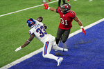Tampa Bay Buccaneers' Antoine Winfield Jr., right, breaks up a two-point conversion-attempt to New York Giants' Dion Lewis during the second half of an NFL football game, Monday, Nov. 2, 2020, in East Rutherford, N.J. (AP Photo/Corey Sipkin)