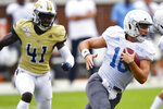 Citadel quarterback Brandon Rainey (16) runs out of the pocket against Georgia Tech during the first half of an NCAA college football game, Saturday, Sept. 14, 2019, in Atlanta. (AP Photo/Mike Stewart)