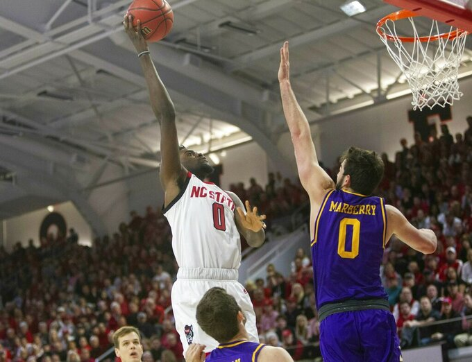 North Carolina State's DJ Funderburk (0) shoots over Lipscomb's Rob Marberry (0) during the first half of an NCAA college basketball game in the quarterfinals of the NIT on Wednesday, March 27, 2019, in Raleigh, N.C. (Travis Long/The News & Observer via AP)