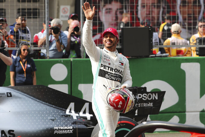 Mercedes driver Lewis Hamilton of Britain waves to supporters after clinching second position during the qualifying session for the Chinese Formula One Grand Prix at the Shanghai International Circuit in Shanghai on Saturday, April 13, 2019. Valtteri Bottas claimed the pole position for Sunday's Chinese Grand Prix with Mercedes teammate Lewis Hamilton claiming the second spot on the grid. (AP Photo/Ng Han Guan)