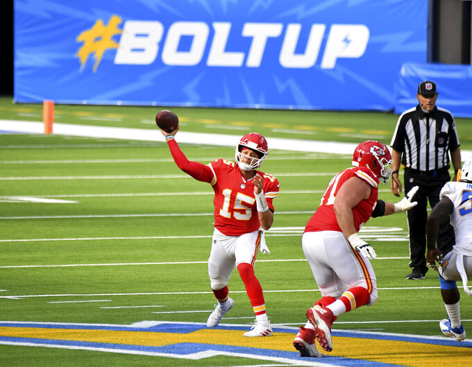 Quarterback Patrick Mahomes of the Kansas City Chiefs passes against the Los Angeles Chargers in the second half of an NFL football game at SoFi Stadium in Inglewood, Calif., on Sunday, Sept. 20, 2020. Kansas City Chiefs won 23-20 in overtime. (Keith Birmingham/The Orange County Register via AP)