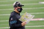 Philadelphia Eagles head coach Doug Pederson watches play against the Dallas Cowboys in the second half of an NFL football game in Arlington, Texas, Sunday, Dec. 27. 2020. (AP Photo/Michael Ainsworth)