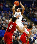Penn State's Rasir Bolton (13) takes a shot over Wisconsin's D'Mitrik Trice (0) during second half action of an NCAA college basketball game in State College, Pa. Sunday, Jan. 6, 2019. Wisconsin won 71-52. (AP Photo/Chris Knight)