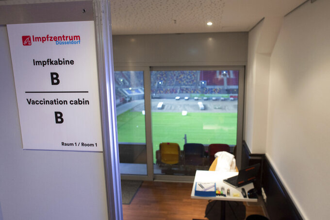 The vaccination booth 'B' is pictured in a vaccination center in a soccer stadium, home of German second division team Fortuna Duesseldorf, in Duesseldorf, Germany, Tuesday, Dec. 1, 2020. The German government is preparing to roll out a nationwide coronavirus vaccination program. (Federico Gambarini/dpa via AP)