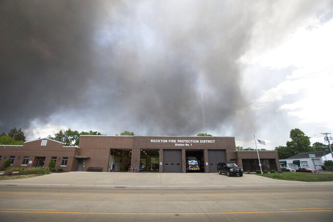 Black smoke cloud from the massive industrial fire at Chemtool on Prairie Hill Road darkens the sky over Rockton Fire Protection District Station 1 Monday, June 14, 2021,  in Rockton, Ill. (Scott P. Yates/Rockford Register Star via AP)