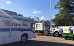 This Sept. 19, 2018, photo provided by AT&T shows equipment, center, that turns a satellite signal into an LTE cell tower that was used during Hurricane Florence in Marion, South Carolina. The equipment is a supplementary part of FirstNet, a new national wireless network dedicated for first responders. A major earthquake that rocked Alaska proved to be a trial run in the state's largest city for a new national wireless network dedicated to first responders. (AT&T via AP)