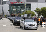 The hearse carrying rapper Nipsey Hussle leaves Staples Center after a memorial service in Los Angeles, Thursday, April 11, 2019. Hussle was killed in a shooting outside his Marathon Clothing store in south Los Angeles on March 31. (AP Photo/Ringo H.W. Chiu)