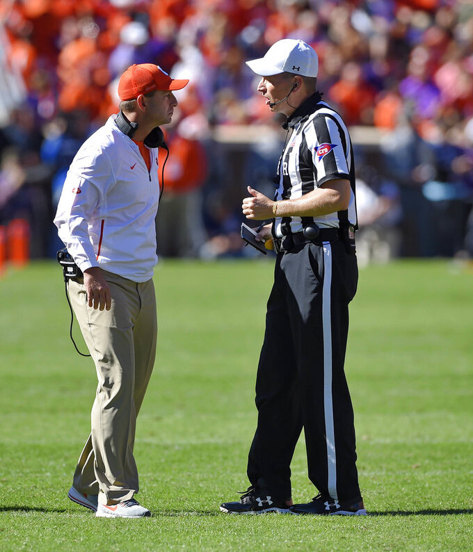 Clemson head coach Dabo Swinney talks with an official during the first half of an NCAA college football game against Louisville, Saturday, Nov. 3, 2018, in Clemson, S.C. (AP Photo/Richard Shiro)