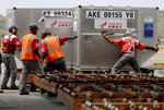 Workers unload medical supplies from a Chinese airplane at the Simon Bolivar International Airport in Maiquetia, near Caracas, Venezuela, Friday, March 29, 2019. Aid was unloaded from the airplane in what Venezuelan officials said would be the first delivery of many from China, an ally of the government of President Nicolas Maduro.(AP Photo/Natacha Pisarenko)