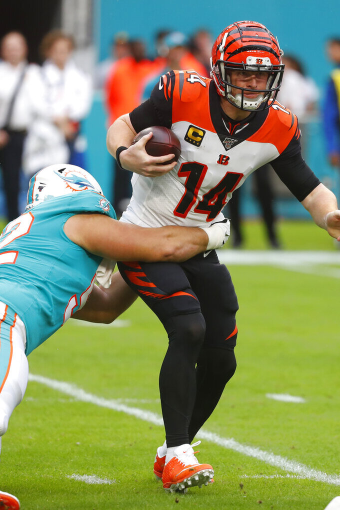 Cincinnati Bengals quarterback Andy Dalton (14) is sacked by Miami Dolphins defensive end Zach Sieler (92), during the first half at an NFL football game, Sunday, Dec. 22, 2019, in Miami Gardens, Fla. (AP Photo/Wilfredo Lee)