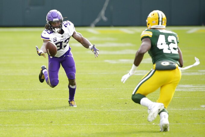 Minnesota Vikings' Dalvin Cook can't catch a pass in front of Green Bay Packers' Oren Burks during the second half of an NFL football game Sunday, Nov. 1, 2020, in Green Bay, Wis. (AP Photo/Mike Roemer)