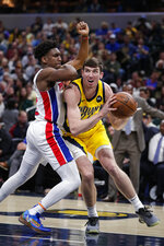 Indiana Pacers forward T.J. Leaf (22) looks to shoot over Detroit Pistons guard Langston Galloway (9) during the second half of an NBA basketball game in Indianapolis, Friday, Nov. 8, 2019. The Pacers won 112-106. (AP Photo/Michael Conroy)