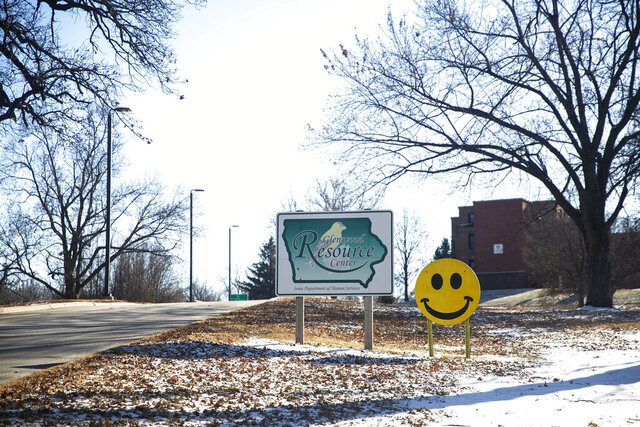 FILE - This Dec. 19, 2019, file photo, shows the entrance to the Glenwood Resource Center campus in Glenwood, Iowa. In a report released Tuesday, Dec. 22, 2020, the U.S. Justice Department has found that Glenwood Resource Center, the Iowa state-run care center for people with intellectual disabilities, likely violated the constitutional rights of residents by subjecting them to human experiments, some of which were deemed dangerous. (Kelsey Kremer/The Des Moines Register via AP, File)