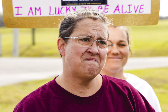 In this Jan. 23, 2020 photo, Janice Spears looks on in anguish as she listens to Rep. Dianne Hart speak of the plight of Florida's criminal justice system during a protest at Lowell Correctional Institute in Ocala, Fla. (Justin Bright/Fresh Take Florida via AP)