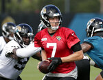 FILE - In this June 11, 2019, file photo, Jacksonville Jaguars quarterback Nick Foles (7) looks to hand off the ball to a running back during the NFL football team's practice in Jacksonville, Fla. Foles was perfect for Philadelphia's offense, and the Jaguars want to be more of a running team. There is something special about Foles, though, so don't doubt him. (AP Photo/John Raoux, File)