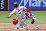 New York Mets shortstop Amed Rosario, right, tags out Philadelphia Phillies' Bryce Harper as he tries to reach second base during the second inning of a baseball game at Citi Field, Sunday, July 7, 2019, in New York. (AP Photo/Seth Wenig)