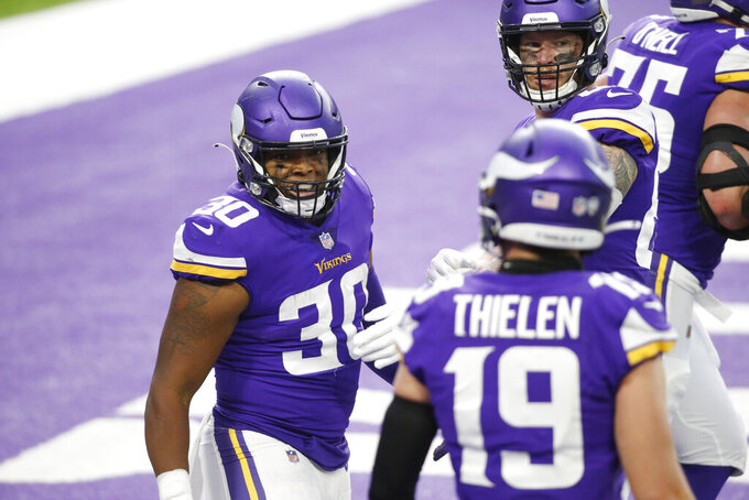Minnesota Vikings fullback C.J. Ham (30) celebrates with teammates after scoring on a 12-yard touchdown reception during the second half of an NFL football game against the Jacksonville Jaguars, Sunday, Dec. 6, 2020, in Minneapolis. (AP Photo/Bruce Kluckhohn)