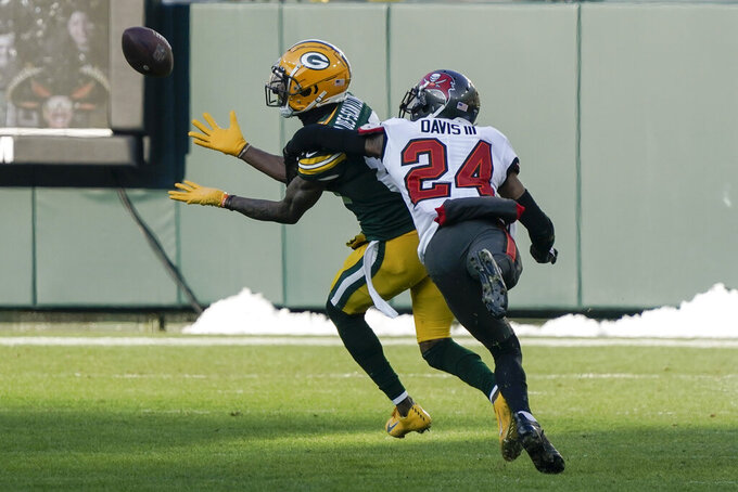 Tampa Bay Buccaneers' Carlton Davis (24) tries to defend against Green Bay Packers' Marquez Valdes-Scantling as he makes a 50-yard touchdown catch during the first half of the NFC championship NFL football game in Green Bay, Wis., Sunday, Jan. 24, 2021. (AP Photo/Morry Gash)