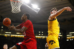 Nebraska guard Jervay Green drives to the basket past Iowa center Luka Garza, right, during the first half of an NCAA college basketball game, Saturday, Feb. 8, 2020, in Iowa City, Iowa. (AP Photo/Charlie Neibergall)