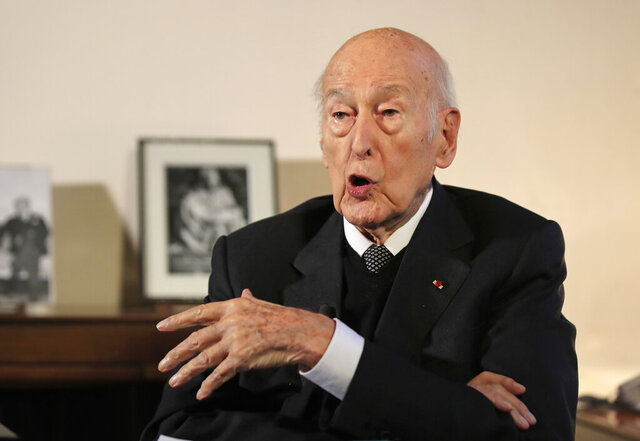 FILE - In this Jan. 30, 2020 file photo, former French President Valery Giscard d'Estaing gestures as he speaks during an interview of the Associated Press in Paris. A German journalist has accused former French President Valery Giscard d'Estaing of repeatedly grabbing her during an interview, and filed a sexual assault complaint with Paris prosecutors, according to French and German news reports. (AP Photo/Michel Euler, File)
