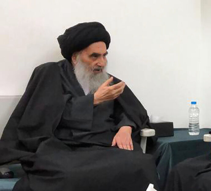 FILE - This handout photo from the office of Grand Ayatollah Ali al-Sistani shows senior Shiite cleric Grand Ayatollah Ali al-Sistani in the southern Iraqi city of Najaf on March, 13, 2019.  At least 13 people were stabbed Thursday, Dec. 5,  in Baghdad's Tahrir Square, the epicenter of Iraq's protest movement, security and medical officials said, stoking fears of infiltration by unknown groups among anti-government demonstrators. The protesters aligned with parties had marched to Tahrir earlier that day, mostly young men clad in black and waiving Iraqi flags. They chanted positive slogans in deference to Grand Ayatollah Ali al-Sistani, Iraq's most powerful Shiite cleric, and stood conspicuous against the usual crowds of Tahrir protesters.  (Office of Grand Ayatollah Ali al-Sistani, via AP)