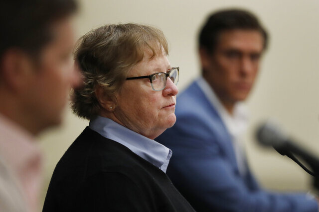 Cathy Kalahar addresses the media, Tuesday, July 14, 2020, during a news conference in Novi, Mich. Kalahar is accusing the late Dr. Robert Anderson of sexual abuse while she was a student at the University of Michigan in the 1970s. She is the first female to publicly say she was sexually abused by a team doctor at the school and says she hopes to inspire other women and men to come forward. Kalahar played tennis for the Wolverines in the 1970s.  (AP Photo/Carlos Osorio)