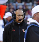 Miami head coach Mark Richt looks up at the scoreboard in the first half an NCAA college football game against Virginia Tech in Blacksburg, Va., Saturday, Nov. 17 2018. (Matt Gentry/The Roanoke Times via AP)