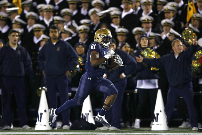 Navy tight end Tre Walker rushes for a touchdown in the second half of an NCAA college football game against Tulsa, Saturday, Nov. 17, 2018, in Annapolis, Md. Navy won 37-29. (AP Photo/Patrick Semansky)