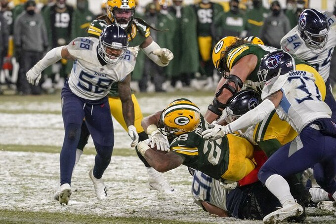 Green Bay Packers' A.J. Dillon runs for a touchdown during the second half of an NFL football game against the Tennessee Titans Sunday, Dec. 27, 2020, in Green Bay, Wis. The Packers won 40-14. (AP Photo/Morry Gash)