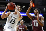 Cincinnati's Zach Harvey (23) drives next to Alabama A&M's Garrett Hicks (10) during the first half of an NCAA college basketball game Thursday, Nov. 14, 2019, in Cincinnati. (AP Photo/John Minchillo)