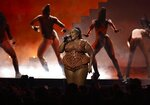 Lizzo performs on stage at the Brit Awards 2020 in London, Tuesday, Feb. 18, 2020. (Photo by Joel C Ryan/Invision/AP)