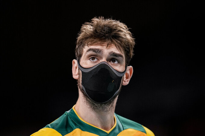 Brazil's Lucas Saatkamp looks on during a men's volleyball preliminary round pool B match between Brazil and United States at the 2020 Summer Olympics, Friday, July 30, 2021, in Tokyo, Japan. (AP Photo/Manu Fernandez)