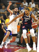 United States' Joe Harris tries to stop France's Rudy Gobert during a quarterfinal match for the FIBA Basketball World Cup in Dongguan in southern China's Guangdong province on Wednesday, Sept. 11, 2019. France defeated United States 89-79. (AP Photo/Ng Han Guan)