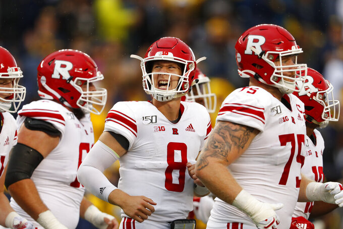 Rutgers quarterback Artur Sitkowski (8) reacts running to the bench in the first half of an NCAA college football game against Michigan in Ann Arbor, Mich., Saturday, Sept. 28, 2019. (AP Photo/Paul Sancya)