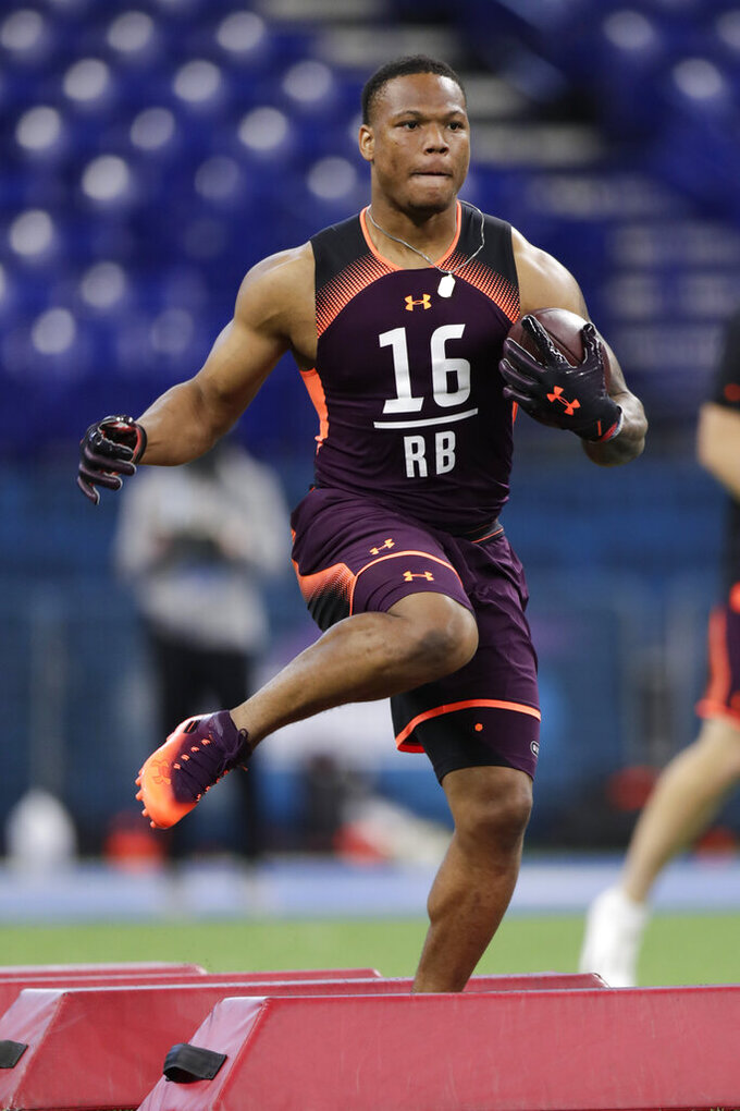 Iowa State running back David Montgomery runs a drill at the NFL football scouting combine in Indianapolis, Friday, March 1, 2019. (AP Photo/Michael Conroy)