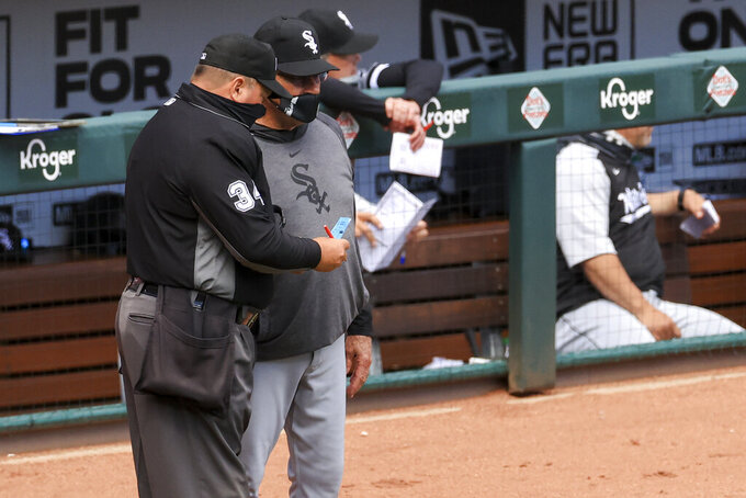 MLB umpire Sam Holbrook, left, talks with Chicago White Sox Tony La Russa during the ninth inning of a baseball game in Cincinnati, Wednesday, May 5, 2021. The Reds won 1-0. (AP Photo/Aaron Doster)