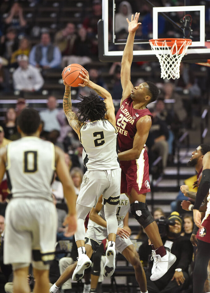 Wake Forest's Sharon Wright, Jr. (2) drives to the basket as Florida State's Mfiondu Kabengele (25) defends during the second half of their NCAA college basketball game on Saturday, March 9, 2019 in Winston-Salem, N.C. Florida State beat Wake Forest 65 to 57. (AP Photo/Woody Marshall)