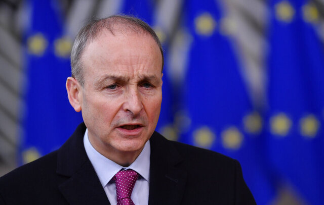 FILE - In this file photo dated Thursday, Dec. 10, 2020, Ireland's Prime Minister Micheal Martin speaks as he arrives at the European Council building in Brussels.  The Irish Prime Minister Micheal Martin seems poised to make a formal apology on behalf of the Irish state, for the deaths of thousands of infants and other abuses in church-run homes for unmarried women and their babies, following inquiry findings due to be published on Tuesday Jan. 12, 2021. (John Thys/ Pool FILE via AP)