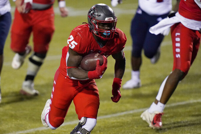 New Mexico running back Nathaniel Jones (25) runs for a touchdown against Fresno State during the second half of an NCAA college football game Saturday, Dec. 12, 2020, in Las Vegas. (AP Photo/John Locher)