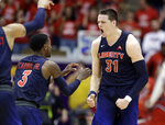 Liberty forward Scottie James (31) celebrates with Lovell Cabbil Jr. (3) after James made a free throw late in the second half of the Atlantic Sun NCAA college basketball tournament championship game against Lipscomb Sunday, March 10, 2019, in Nashville, Tenn. Liberty won 74-68. (AP Photo/Mark Humphrey)