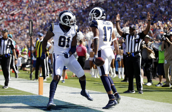 Los Angeles Rams' Robert Woods (17) celebrates after scoring a touchdown with Gerald Everett (81) during the first half of an NFL football game against the San Francisco 49ers Sunday, Oct. 13, 2019, in Los Angeles. (AP Photo/Alex Gallardo)